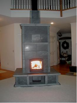 2700 Tulikivi Fireplace with Benches in New Hampshire