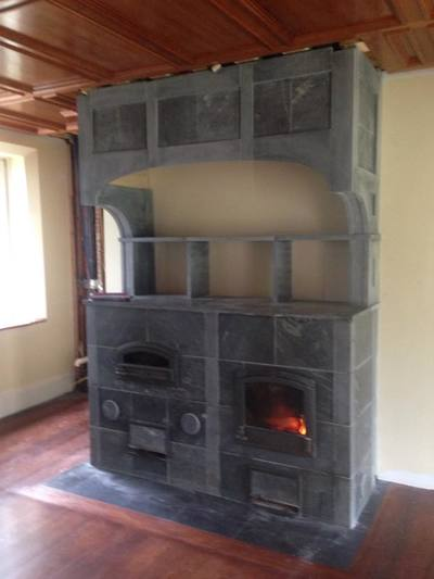 Side-by-side Fireplace and Bakeoven with Soapstone Hood Custom Tulikivi in Gloucester, Massachusetts