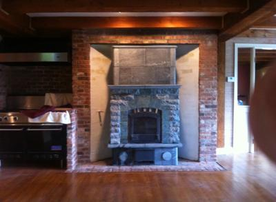Tulikivi Heater Installed in Converted Open Masonry Fireplace. Used Fireplace Moved from Jamestown, Rhode Island to Concord, New Hampshire.